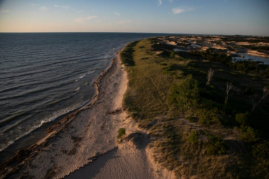 The shoreline of Lake Michigan seen from Big Sable Point Lighthouse in Ludington Sate Park Thursday, July 11, 2019.