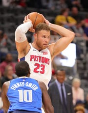Detroit Pistons forward Blake Griffin (23) passes against Dallas Mavericks forward Dorian Finney-Smith (10) during second period action Wednesday, October 9, 2019 at Little Caesars Arena in Detroit, Mich.