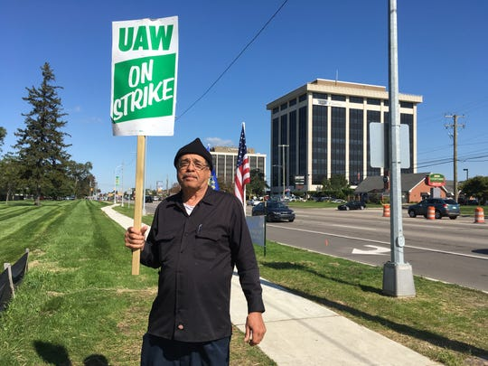 Leroy Banner of Warren, a painter's helper for Aramark at the GM Tech Center, pickets at Gate 9 at the GM Tech Center.