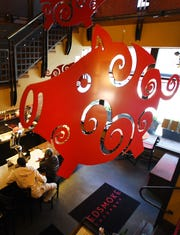 When pigs fly is a real thing at the Red Smoke Barbecue in Greektown, hovering above guests from the second floor.