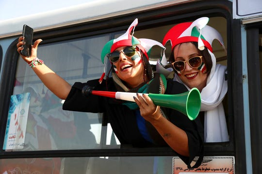 Iranian women cheer as they arrive to the Azadi Stadium to watch the 2022 World Cup qualifier soccer match between Iran and Cambodia, in Tehran, Iran, Thursday, Oct. 10, 2019. Iranian women were freely allowed into the stadium for the first time in decades. They had been banned since 1981.