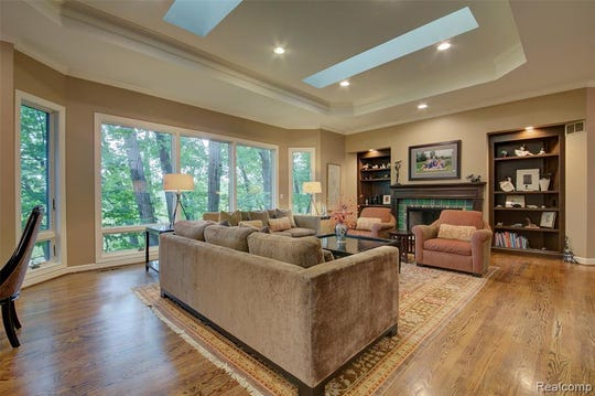 This five-bedroom Cape Cod-style estate in Ann Arbor estate lists for  $950,000 and offers treetop views that overlook Fleming Creek from its private deck, which is attached to a sunroom with a gas fireplace. Motawi tile inlay floors lead to an array of custom designs throughout. The large master bedroom with his-and-hers walk-in closetshas a newly updated master bath. A fully-finished walkout basement with a kitchenette, recreation room, gym, three bedrooms and two bathrooms.