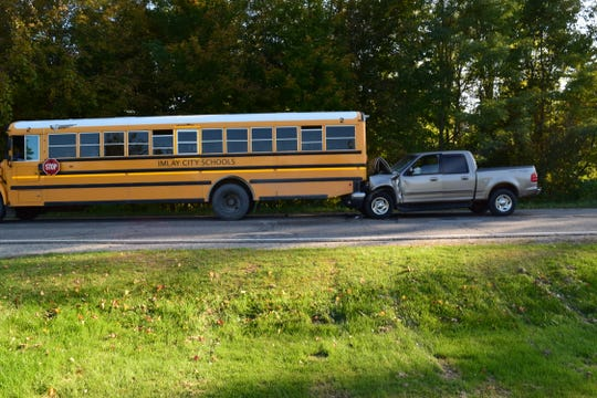 An Imlay City School bus was transporting elementary school students home when the pickup truck crashed into its rear.