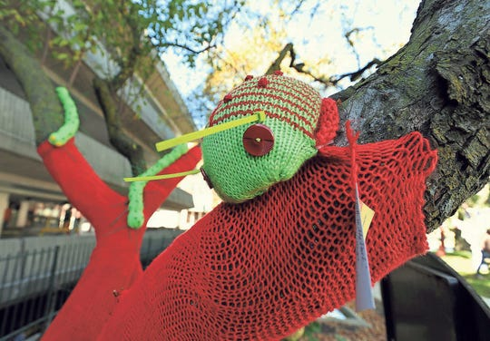 This knitted bug perches on a red yarn-covered tree, one of several trees wrapped and adorned with creatures of all sorts in a park in Birmingham in 2012.