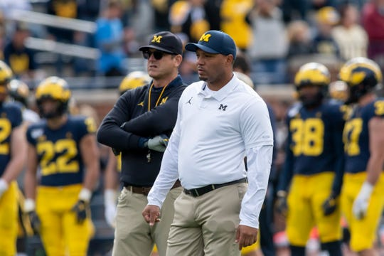 Jim Harbaugh, left, and offensive coordinator Josh Gattis will look to kick Michigan's offense into another gear this weekend at Illinois.
