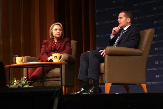 (From left) Former U.S. Secretary of State Hillary Rodham Clinton and dean of public policy Michael Barr have a conversation on foreign policy at Rackham Auditorium on the campus of the University of Michigan, in Ann Arbor, October 10, 2019.