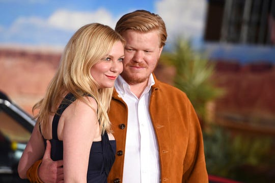 """Kirsten Dunst, left, and Jesse Plemons arrive at the Los Angeles premiere of """"El Camino: A Breaking Bad Movie,"""" at the Regency Village Theatre, Monday, Oct. 7, 2019."""