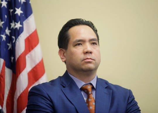"FILE - In this Feb. 23, 2017, file photo, Utah Attorney General Sean Reyes looks on during a news conference at the Utah State Capitol in Salt Lake City. In a Wednesday, Oct. 9, 2019 statement, Reyes said Maricopa County, Ariz., Assessor Paul Petersen ""is alleged to have run an illegal adoption scheme where he recruited, transported, and offered payment to pregnant Marshallese women to give their babies up for adoption in the United States."""