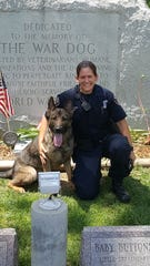 Bloomfield Twp. Officer Angela Carlson poses with K-9 partner Kody