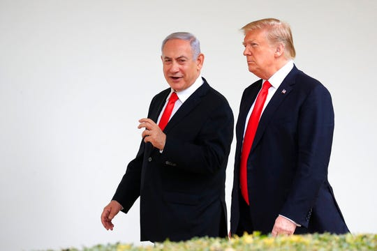 In this March 25, 2019, file photo, President Donald Trump and visiting Israeli Prime Minister Benjamin Netanyahu walk along the Colonnade of the White House in Washington.
