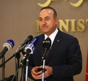 Turkey's Foreign Minister Mevlut Cavusoglu speaks to the media during a joint news conference with Algeria's Foreign Minister Sabri Boukadoum, in Algiers, Algeria, Wednesday, Oct. 9, 2019.