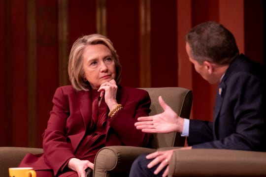 (From left) Former U.S. Secretary of State Hillary Rodham Clinton and Dean of Public Policy Michael Barr have a conversation on foreign policy at Rackham Auditorium on the campus of the University of Michigan, in Ann Arbor, Thursday.