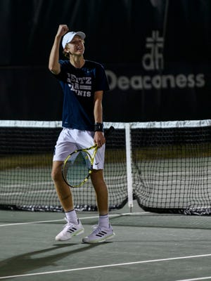 Reitz's William Hays reacts to winning the no. 2 singles match against Castle's Aneesh Alapati, not pictured, during the IHSAA regional championship at North High School in Evansville, Wednesday evening, Oct. 9, 2019. Hays clinched a three set win over Alapati to help Reitz gain its first regional title in school history.