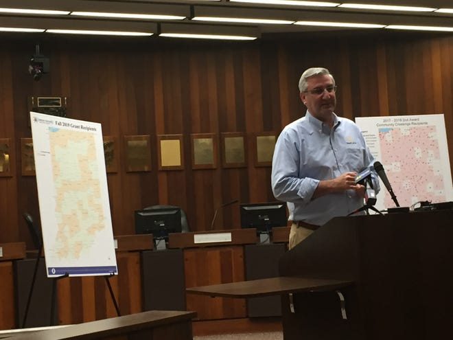 Indiana Gov. Eric Holcomb visited Evansville to formally distribute Community Crossings grants to Southwest Indiana elected officials. The grants support local road projects.