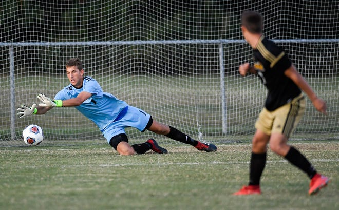 Castle goalie Nigel Stoltz (1) chases down a goal shot as the Castle Knights play the Jasper Wildcats in the 3A boys soccer sectional semifinals at the EVSC Soccer Complex Wednesday afternoon, October 9, 2019.