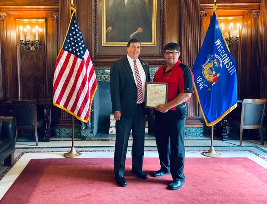 Bob Belling, of Lomira, received the First Responder of the Year Award from the Wisconsin State Assembly Thursday, Oct. 10, 2019. Belling, left, is from the 39th Assembly District, represented by Rep. Mark Born, right.