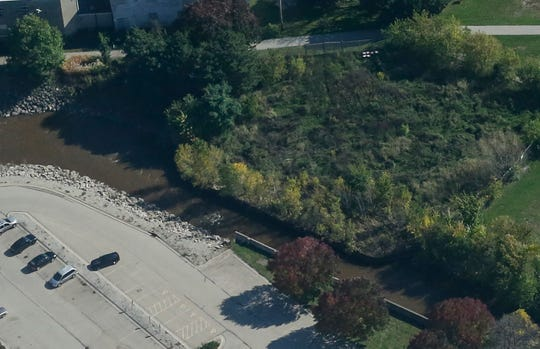 An aerial view of the Fond du Lac River at the former QuicFrez site shows the width of the river is cut in half  due to metal sheet used contain soil contamination. This potentially contributes to flooding of nearby Fruth Athletic Field. DNR officials are working with the city to remove these obstructions from the waterway. Wednesday, October 9,