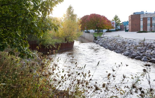 The east bank of the east branch of the Fond du Lac River has been built up with metal sheet piling to contain soil contamination at the former QuicFrez site, which reduces the width of the river, and potentially contributes to flooding of nearby Fruth Athletic Field, as shown on Wednesday, Oct. 9, 2019.