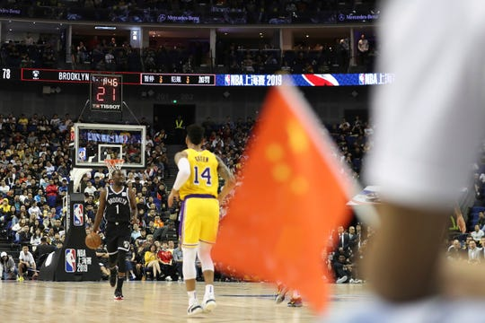 Nets' Theo Pinson, left, drives against Lakers' Danny Green during a preseason game at the Mercedes Benz Arena in Shanghai, China, Thursday.