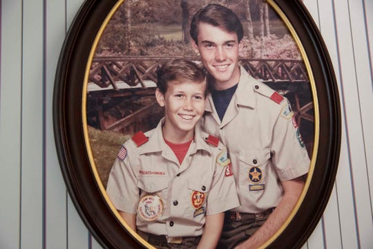 A portrait of Aaron Averhart, left, and his brother Scott Adkins, right, hangs on the wall at their parents' house in North Fort Myers on Wednesday, September 4, 2019. Averhart says that when he attended Camp Miles in the late 80s as a young Boy Scout he was sexually abused by camp counselor Bill Sheehan.