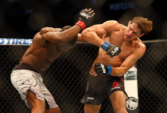 Jul 27, 2019; Edmonton, Alberta, Canada; Geoff Neal (red gloves) and Niko Price (blue gloves) during UFC 240 at Rogers Place. Mandatory Credit: Sergei Belski-USA TODAY Sports