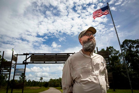 Aaron Averhart poses for a portrait outside the entrance to Camp Miles in Punta Gorda on Wednesday, September 4, 2019. Averhart says that when he attended the camp in the late 80s as a young Boy Scout he was sexually abused by camp counselor Bill Sheehan.