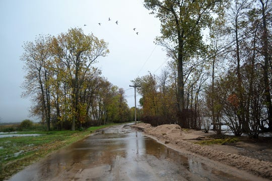A section of the 6300 block of Bayshore Road in Oconto seen on Sept. 10, after sand that had been washed up by waves from the bay had been plowed to the side by the City of Oconto.