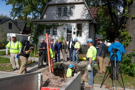 Green Bay utility workers replace a lead service line with a copper pipe Thursday, Oct. 10, 2019, at 712 Howard St. in Green Bay as EPA officials look on.