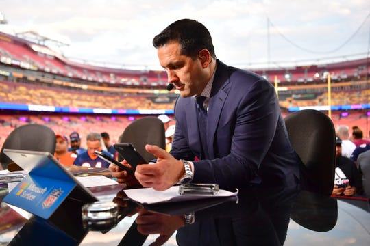 "Adam Schefter works on the set of ""Monday Night Countdown"" at FedExField in September."