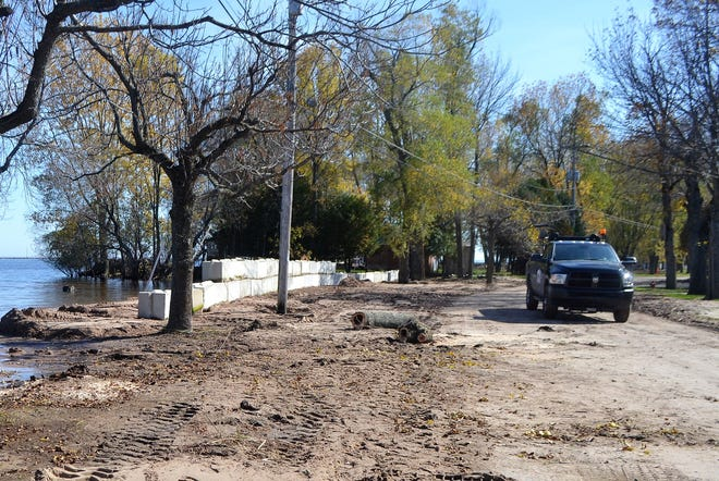 City of Oconto employees on Wednesday placed 36 large concrete blocks between the bay and Bayshore Drive. Over the past several months, waves have deposited sand on the road, and officials want to make sure its protected over the winter.