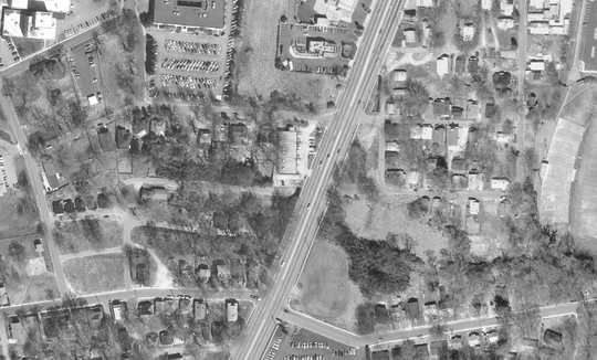 This satellite image of the Haynie-Sirrine community from 1997 shows dozens of homes still standing to the left and right of Church Street, which runs throuhg the center of the photo.