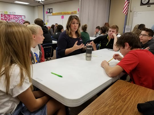 Becky Timmons, of Montana Federal Credit Union, shares advice to students during mock interviews at North Middle School. More than 50 volunteers are still needed to help out on Thursday, Oct. 24.