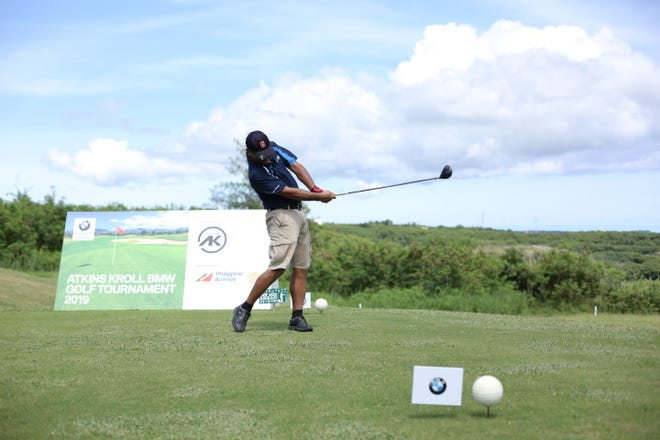 A BMW customer drives a shot at the LeoPalace Resort Country Club during the first annual AK BMW Premiere Golf Tournament on Oct. 6. More than a hundred AK BMW customers competed for BMW prizes and the opportunity to represent Guam at the BMW Golf Cup International Final 2019 in The Philippines.