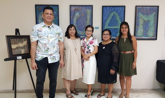 """Diversity through the Art"" exhibit opened October 4, 2019 at the Agana Shopping Center.  The exhibit features works of local artists in all different mediums. Artist Yeon Sook Park's art pieces have been on display. The exhibit is free and open to the community till Oct. 31. Pictured From left with CAHA staff Mark Duenas, Angie Taitague, artist Yeon Sook Park, Jackie Balbas, and Sherrie Barcinas."