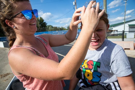 """I really want to be a role model and take her under my wing,"" said Krista Baldwin, a third generation NHRA drag racer on Tuesday, Oct. 1, while fixing Kolette Dicero's hair after quarter midget practice. ""Both of our names start with K and we call each other sisters. We both lean on each other."" Baldwin met Dicero in Charlotte when Dicero was three years old."