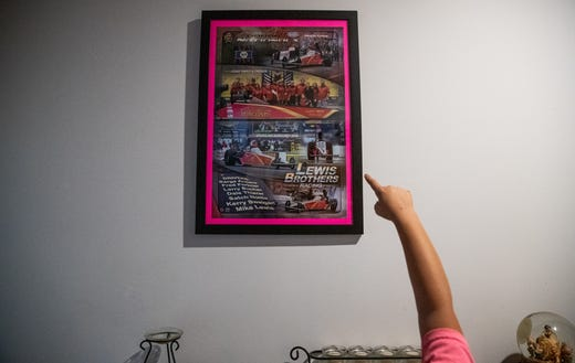 Kolette points to a Lewis Brothers Racing poster hanging on her family's wall inside their Pittsboro, Ind., home on Wednesday, Sept. 18, 2019.
