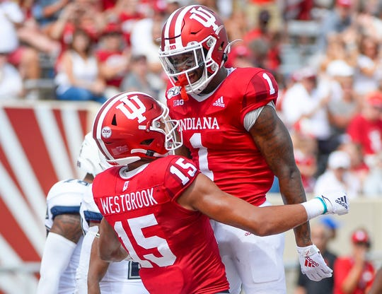 Receivers Whop Philyor (1) and Nick Westbrook (15) are benefitting from a more explosive IU offense.