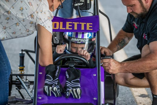 Kolette Dicero pumps herself up before a quarter midget practice run at Indy Mini Speedway at the Indiana State Fairgrounds on Tuesday, Oct. 1, 2019.