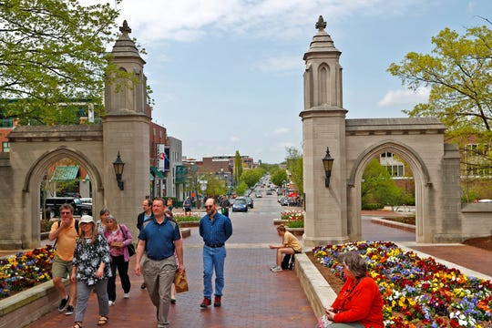 The iconic Sample Gates are seen on the Indiana University campus in Bloomington, Tuesday, April 23, 2019. They look from the campus out to Kirkwood Ave,