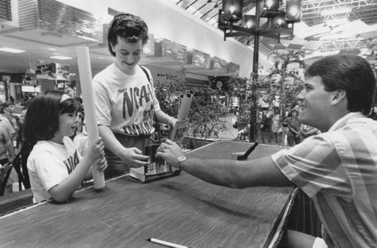 May 1987: Parents and children lined up to get autographs from Indiana University basketball star Steve Alford at Castleton Square Mall. Getting autrographs were Kristin Adams and her daugher, Sarah, 6.