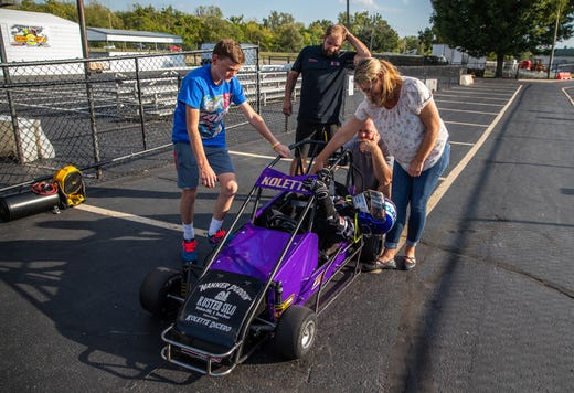 Kolette Dicero, 7, climbs out of her quarter midget after practice at Indy Mini Speedway at the Indiana State Fairgrounds on Tuesday, Oct. 1, 2019.