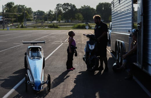 Anthony and Kolette Dicero wrap up their evening at Lucas Oil Raceway after junior dragster practice on Wednesday, Aug. 7, 2019.