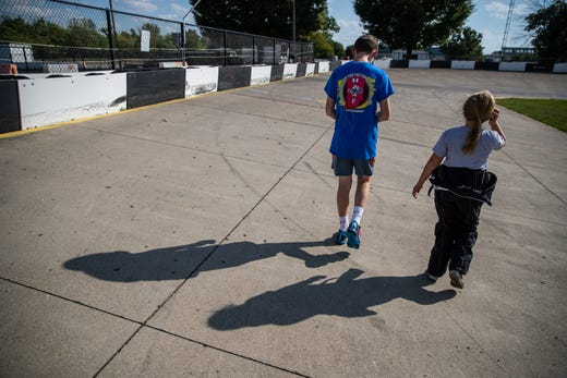 Kolette walks over to turn three on the track with her friend, Ryan Thomas, at Indy Mini Speedway at the Indiana State Fairgrounds on Tuesday, Oct. 1, 2019. Thomas, who also races, wanted to give her a couple pointers about driving the turns.