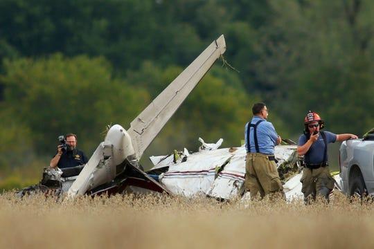 In this Saturday, Oct. 5, 2019, photo, authorities investigate a fatal single-engine plane crash east of Kokomo, Ind. (Tim Bath/The Kokomo Tribune via AP)