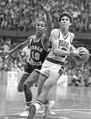 Steve Alford (right) of New Castle steals the ball from Broad Ripple's Donnie Harris on his way in for a layup on March 21, 1983.