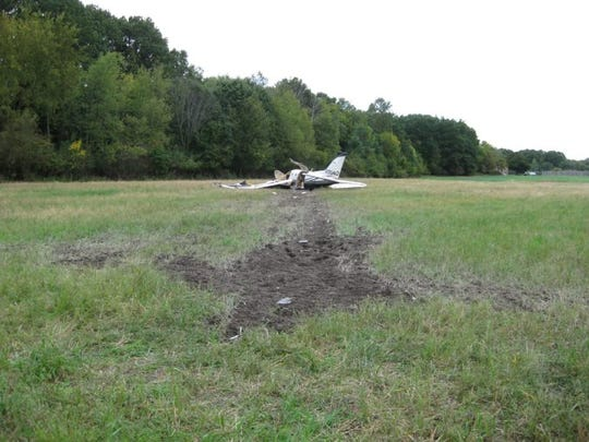 This photo shows the scar caused by a single-engine plane that crashed in Watertown Township on Oct. 3,  killing five Indiana men and seriously injuring another.