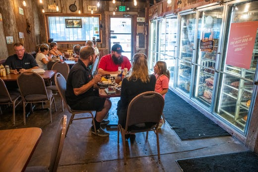 Kolette Dicero, along with her parents, Anthony and Jess, meets with race car sponsor Rob Ecker, owner of Rusted Silo Southern BBQ & Brew House in Lizton, Ind., on Wednesday, Sept. 18, 2019. ÒSheÕs all girl but her passion is very apparent,Ó said Ecker, who sponsors two other drivers, ÒWe want to help make dreams come true for her.Ó