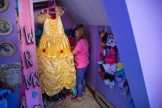 Kolette sorts through her collection of princess dresses hanging in the room inside her Pittsboro, Ind., home on Wednesday, Sept. 18, 2019. ÒI donÕt want her to stop being a girlie-girl,Ó he says, Òbut I still like that she races.Ó