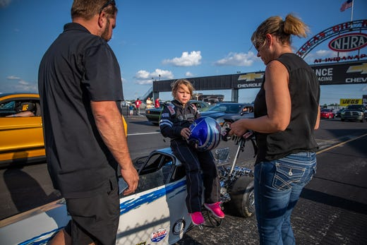 Kolette Dicero sits on top of her junior dragster before a test run down the strip at Lucas Oil Raceway on Wednesday, Aug. 7, 2019.