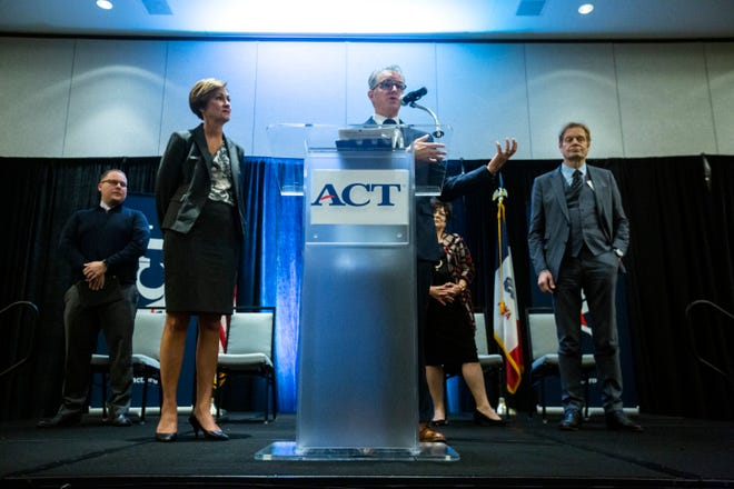 Mark Nolte, president of the Iowa City Area Development Group, speaks during a press conference at ACT's computational psychometrics conference alongside Iowa Gov. Kim Reynolds, left, and Marten Roorda, CEO of ACT, at right, Thursday, Oct., 10, 2019, at the Coralville Marriott Hotel & Conference Center in Coralville, Iowa.